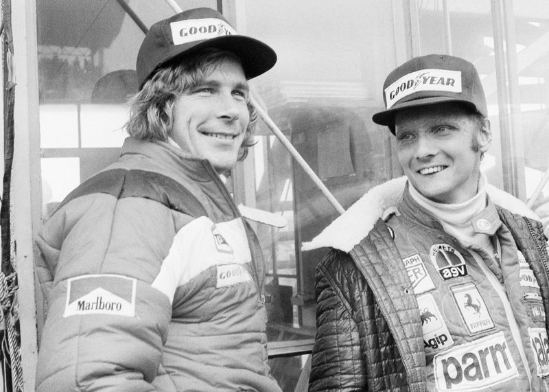 FILE - In this Oct. 24, 1976, file photo, Austrian auto racer Niki Lauda, right, defending champion in world driving, and James Hunt, of Britain, look at the rain before the start of the Japan Grand Prix Formula One auto race at Fuji International Speedway, Gotemba, Japan. Three-time Formula One world champion Niki Lauda, who won two of his titles after a horrific crash that left him with serious burns and went on to become a prominent figure in the aviation industry, has died. He was 70. The Austria Press Agency reported Lauda's family saying in a statement he