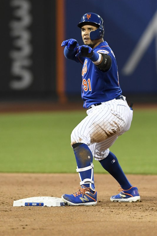 New York Mets' Carlos Gomez reacts at second base after hitting an RBI-double during the third inning of a baseball game against the Washington Nationals, Monday, May 20, 2019, in New York. (AP Photo/Sarah Stier)