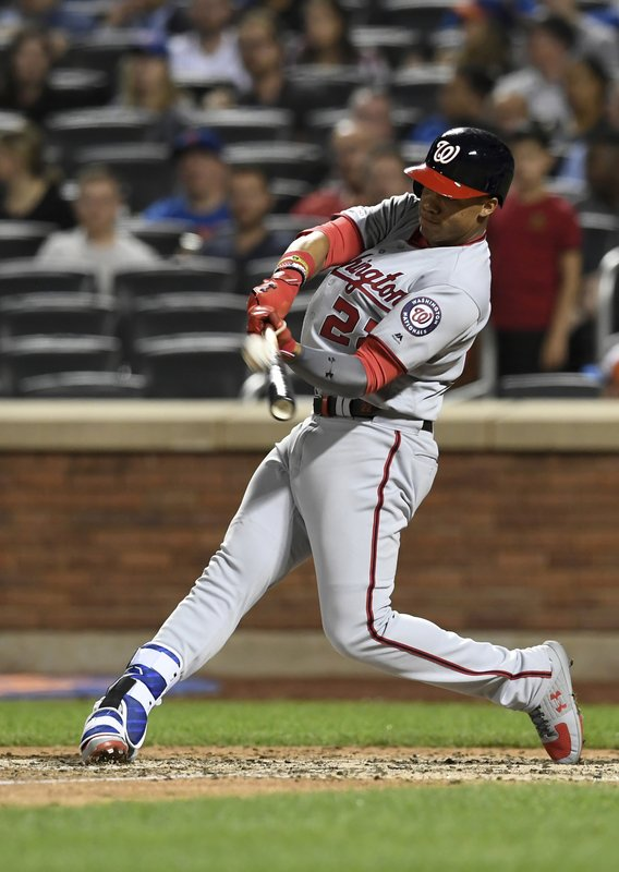 Washington Nationals' Juan Soto flies out to right field during the fifth inning of a baseball game against the New York Mets, Monday, May 20, 2019, in New York. (AP Photo/Sarah Stier)