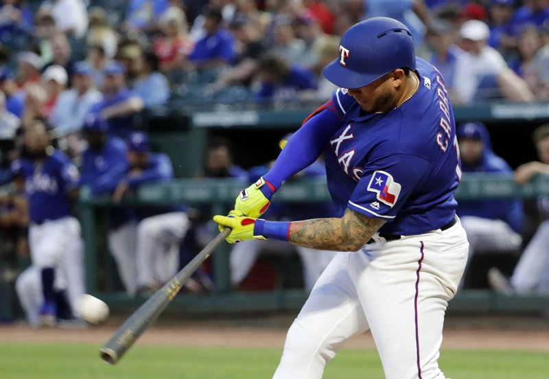 Texas Rangers' Asdrubal Cabrera connects for a solo home run in the fourth inning of a baseball game against the Seattle Mariners in Arlington, Texas, Monday, May 20, 2019. The shot was Cabrera's second of the game off Mariners starter Mike Leake. (AP Photo/Tony Gutierrez)