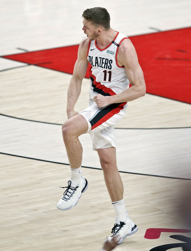 Portland Trail Blazers forward Meyers Leonard reacts after making a basket against the Golden State Warriors during the first half of Game 4 of the NBA basketball playoffs Western Conference finals Monday, May 20, 2019, in Portland, Ore. (AP Photo/Craig Mitchelldyer)