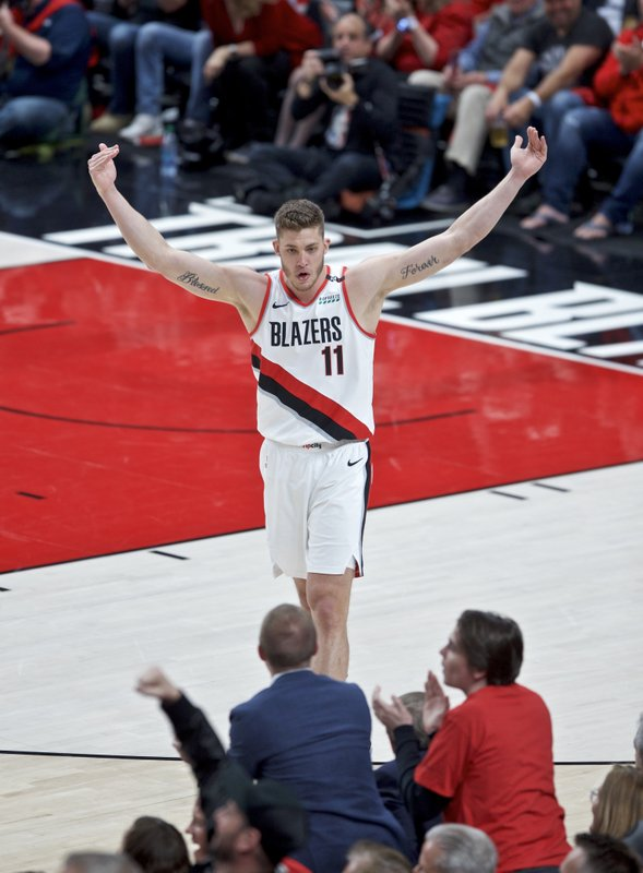 Portland Trail Blazers forward Meyers Leonard gestures to the crowd during the first half of Game 4 of the NBA basketball playoffs Western Conference finals against the Golden State Warriors, Monday, May 20, 2019, in Portland, Ore. (AP Photo/Craig Mitchelldyer)