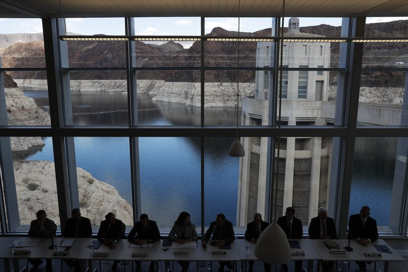 Representatives from seven states and the federal government sit during a news conference at Hoover Dam before a ceremony for a Colorado River drought contingency plan, Monday, May 20, 2019, in Boulder City, Nev. (AP Photo/John Locher)