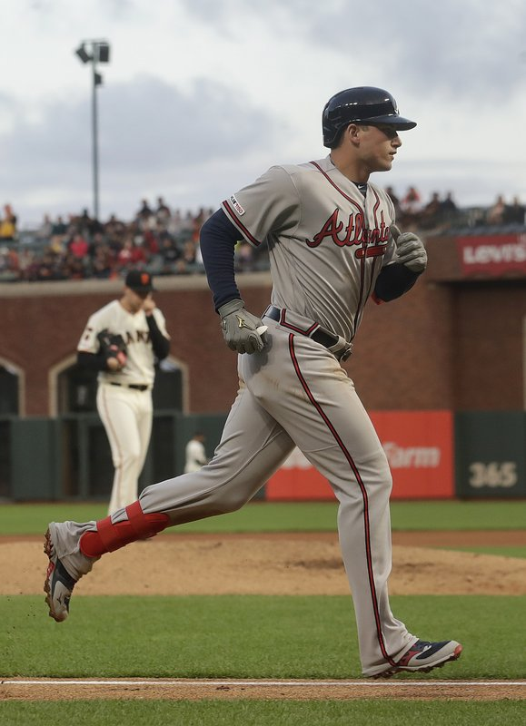 Atlanta Braves' Austin Riley rounds the bases after hitting a two-run home run off of San Francisco Giants' Andrew Suarez, back left, during the sixth inning of a baseball game in San Francisco, Monday, May 20, 2019. (AP Photo/Jeff Chiu)