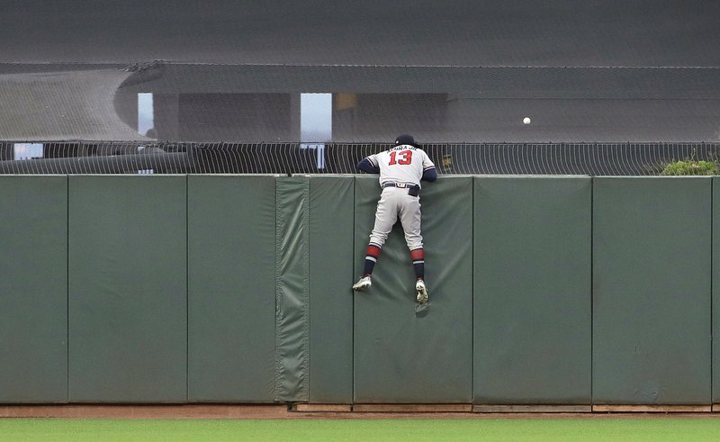 Atlanta Braves center fielder Ronald Acuna Jr. (13) watches as a home run by San Francisco Giants' Brandon Crawford lands in the outfield during the sixth inning of a baseball game in San Francisco, Monday, May 20, 2019. (AP Photo/Jeff Chiu)