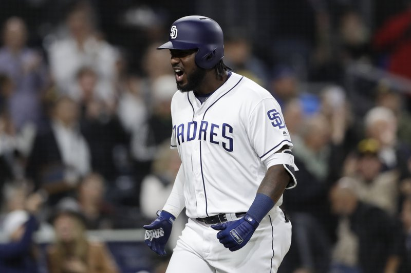 San Diego Padres' Franmil Reyes reacts after hitting a two-run home run during the sixth inning of a baseball game against the Arizona Diamondbacks, Monday, May 20, 2019, in San Diego. (AP Photo/Gregory Bull)