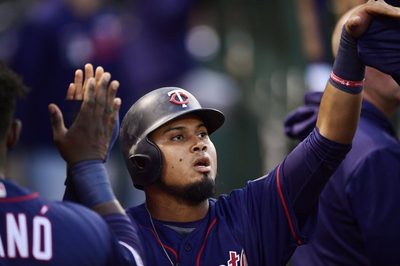 Minnesota Twins' Luis Arraez is congratulated by teammates after scoring on a fielder's choice hit by Ehire Adrianza during the second inning of a baseball game against the Los Angeles Angels, Monday, May 20, 2019, in Anaheim, Calif. (AP Photo/Mark J. Terrill)