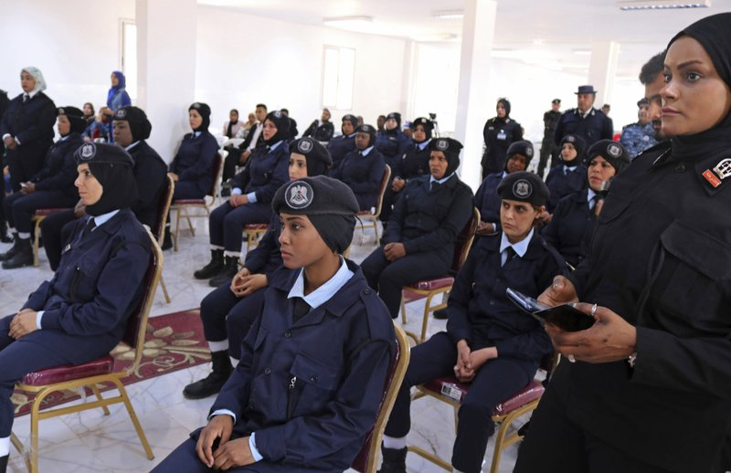 In this May 2, 2019 photo, policewomen cadets attend their graduation ceremony in Benghazi, Libya. After years of assassinations, bombings and militia firefights, Libya's eastern city of Benghazi finally feels safe again -- but security has come at a staggering cost. Forces loyal to Khalifa Hifter, who now controls eastern Libya, have cracked down on dissent. In a report issued last month, the Tripoli-based Libyan Center for Freedom of the Press documented 29 attacks on reporters by Hifter's forces over the past year and a half, more than any other armed group. (AP Photo/Rami Musa)