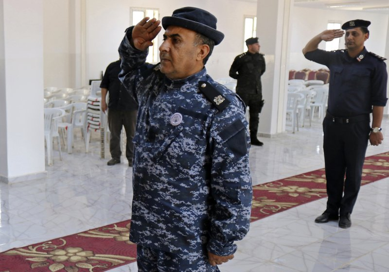 In this Thursday, May 2, 2019 photo, police attend their graduation ceremony in Benghazi, Libya. After years of assassinations, bombings and militia firefights, Libya's eastern city of Benghazi finally feels safe again -- but security has come at a staggering cost. Forces loyal to Khalifa Hifter, who now controls eastern Libya, have cracked down on dissent. In a report issued last month, the Tripoli-based Libyan Center for Freedom of the Press documented 29 attacks on reporters by Hifter's forces over the past year and a half, more than any other armed group. (AP Photo/Rami Musa)