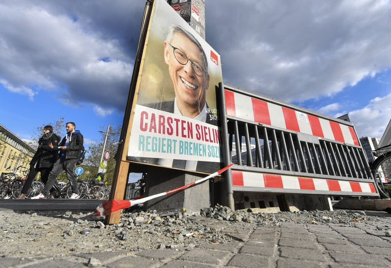 In this Tuesday, May 14, 2019 photo, a poster of SPD promotes the governing mayor of Bremen Carsten Sieling for the regional elections beside road works in the center of Bremen, Germany. The city became a battleground for EU's fragile political center, support for Germany's Social Democrats has ebbed dramatically in recent years, but nowhere is their fate more closely watched than in the tiny city-state of Bremen. (AP Photo/Martin Meissner)
