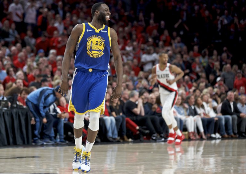 Golden State Warriors forward Draymond Green reacts after making a basket against the Portland Trail Blazers during the second half of Game 4 of the NBA basketball playoffs Western Conference finals Monday, May 20, 2019, in Portland, Ore. The Warriors won 119-117 in overtime. (AP Photo/Craig Mitchelldyer)