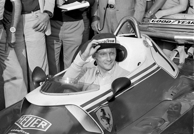 FILE - In this Sept. 7, 1976 file photo Austria's Niki Lauda behind the wheel of his Ferrari 312 T2 on the track of Florano after a near fatal crash on Aug. 1 during the German Grand Prix. Three-time Formula One world champion Niki Lauda, who won two of his titles after a horrific crash that left him with serious burns and went on to become a prominent figure in the aviation industry, has died. He was 70. (AP Photo/Raoul Fornezza, File)