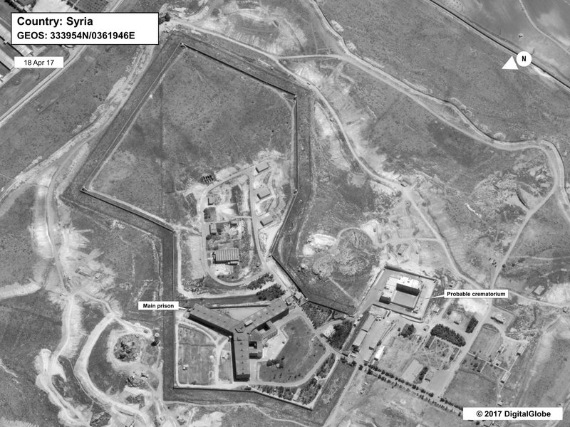 FILE - This April 18, 2017 file satellite image provided by the State Department and DigitalGlobe,  shows what the State Department described as a building in a prison complex in Syria that was modified to support a crematorium. The Syria Justice and Accountability Center, a Washington-based Syrian rights group said in a report, released Tuesday, May 21, 2019, that thousands of documents collected from abandoned Syrian government offices reveal the reach of President Bashar Assad's security agencies, offering a rare glimpse into the inner workings of his secretive apparatus. The documents include handwritten notes from top commanders to