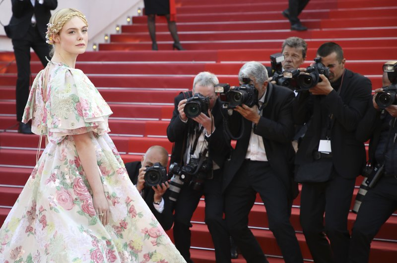 Jury member Elle Fanning poses for photographers upon arrival at the premiere of the film 'Les Miserables' at the 72nd international film festival, Cannes, southern France, Wednesday, May 15, 2019. (Photo by Vianney Le Caer/Invision/AP)