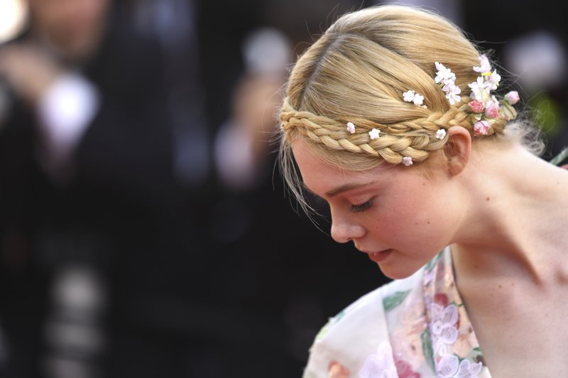 Jury member Elle Fanning poses for photographers upon arrival at the premiere of the film 'Les Miserables' at the 72nd international film festival, Cannes, southern France, Wednesday, May 15, 2019. (Photo by Arthur Mola/Invision/AP)