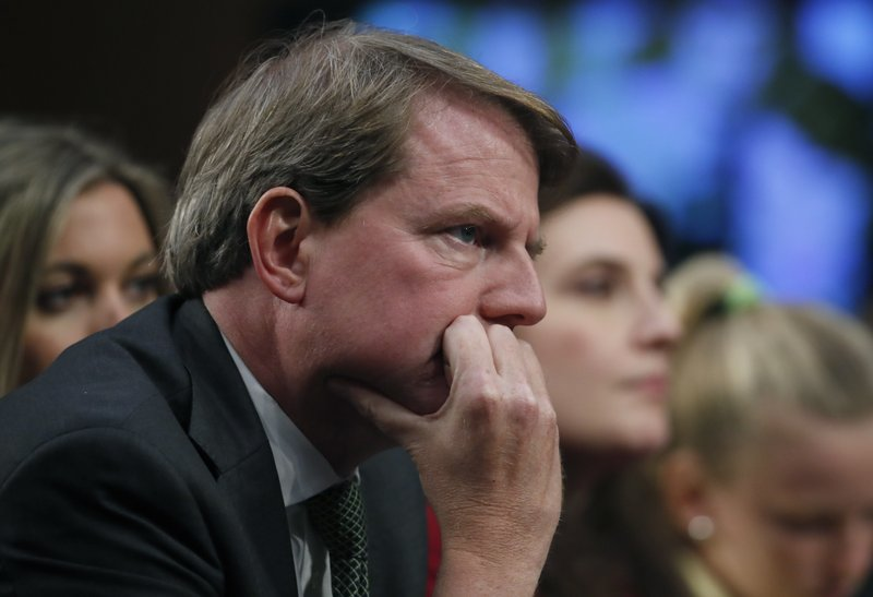 FILE - In this Sept. 6, 2018, file photo, White House counsel Don McGahn listens as President Donald Trump's Supreme Court nominee, Brett Kavanaugh testifies before the Senate Judiciary Committee on Capitol Hill in Washington. A House Judiciary Committee hearing will again be missing its star witness after the White House stepped in. The Democratic-led committee subpoenaed former White House counsel McGahn to appear for the hearing session Tuesday, May 21, but President Donald Trump on Monday directed McGahn to defy the subpoena. (AP Photo/Alex Brandon, File)