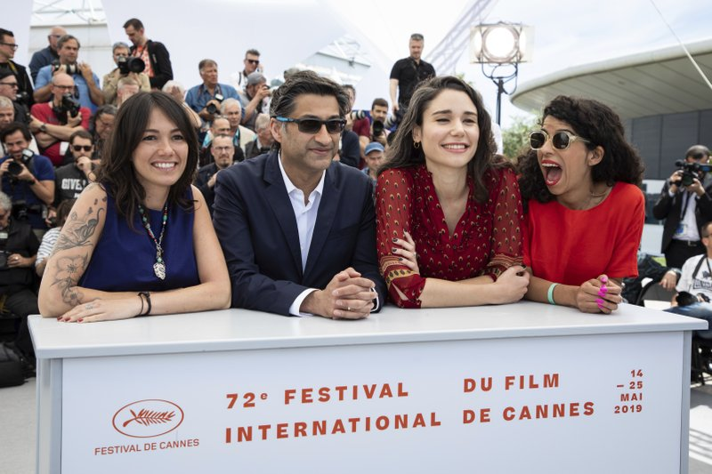 Producers Lina Caicedo, from left Fiammetta Luino, director Asif Kapadia and producer Raquel Alvarez pose for photographers at the photo call for the film 'Diego Maradona' at the 72nd international film festival, Cannes, southern France, Monday, May 20, 2019. (Photo by Vianney Le Caer/Invision/AP)
