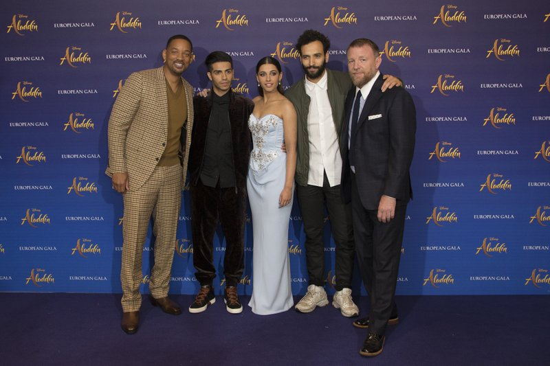 Actors Will Smith, Mena Massoud, Naomi Scott, Marwan Kenzari and Director Guy Ritchie pose for photographers upon arrival at the 'Aladdin' European Gala premiere in London, Thursday, May 9, 2019. (Photo by Joel C Ryan/Invision/AP)