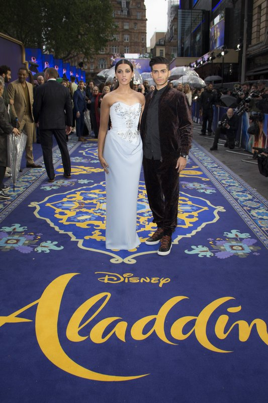 Actors Naomi Scott, left and Mena Massoud pose for photographers upon arrival at the 'Aladdin' European Gala premiere in London, Thursday, May 9, 2019. (Photo by Joel C Ryan/Invision/AP)