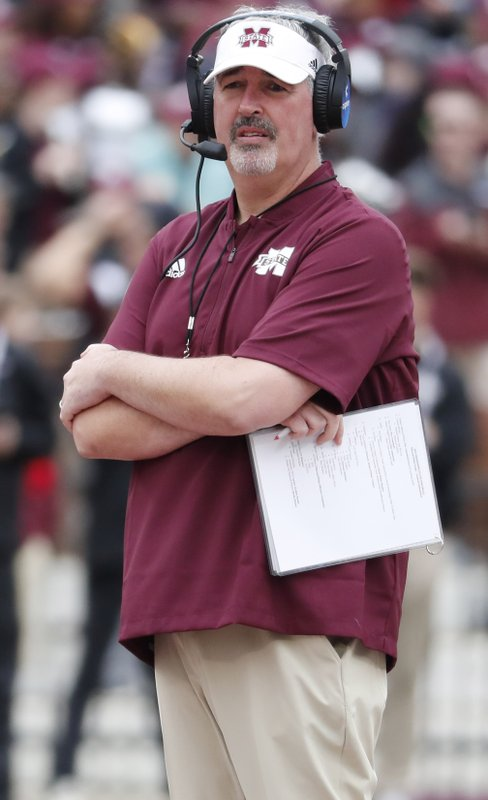 FILE - In this April 13, 2019, file photo, Mississippi State football coach Joe Moorhead observes his team's spring NCAA college football game in Starkville, Miss. Moorhead has received a contract extension through the 2022 season that will pay an average base salary of $3.2 million. The school announced the extension on Tuesday, May 21, 2019. (AP Photo/Rogelio V. Solis, FIle)