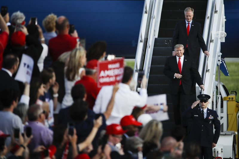 President Donald Trump accompanied by Rep. Fred Keller, R-Snyder, arrive at a campaign rally in Montoursville, Pa., Monday, May 20, 2019. (AP Photo/Matt Rourke)