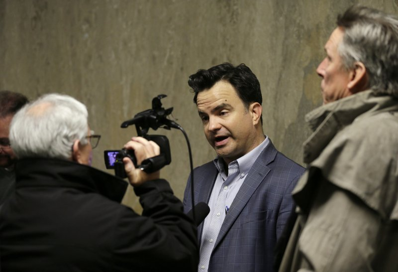 David Snyder, First Amendment Coalition Executive Director, answers questions outside a courtroom Tuesday, May 21, 2019, in San Francisco. A San Francisco police attorney said that a reporter whose office and work equipment was seized in a police raid can collect his property although the legal issues surrounding the case were not resolved Tuesday. San Francisco Superior Court Judge Samuel Feng set dates to hear separate motions to quash search warrants used to raid the home of freelance journalist Bryan Carmody and to unseal those warrants. Media organizations are outraged that police raided a journalist's home. (AP Photo/Eric Risberg)