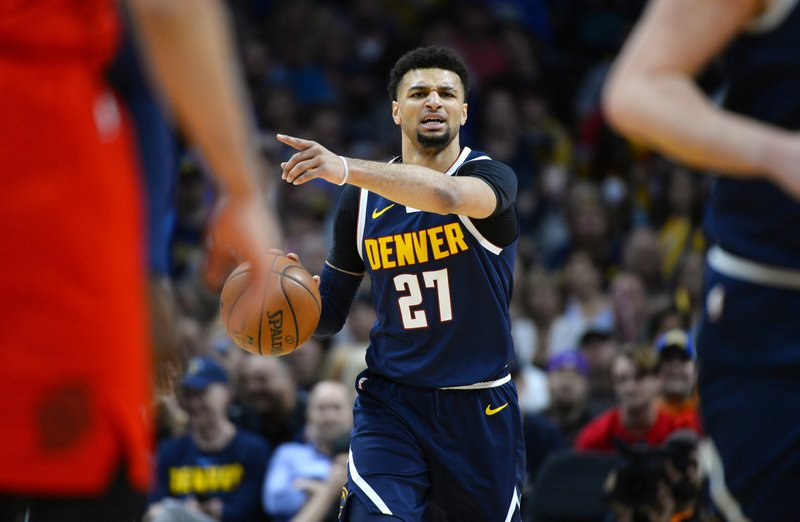 Denver Nuggets guard Jamal Murray directs his team in the first half of Game 7 of an NBA basketball second-round playoff series against the Portland Trail Blazers Sunday, May 12, 2019, in Denver. (AP Photo/John Leyba)