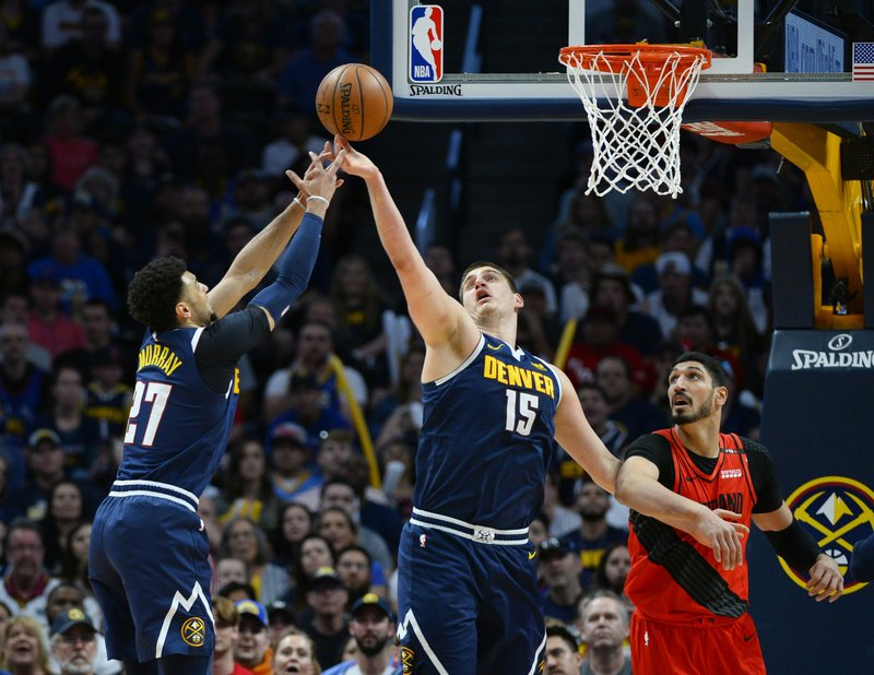 From left, Denver Nuggets guard Jamal Murray and center Nikola Jokic reach for a rebound as Portland Trail Blazers center Enes Kanter looks on in the first half of Game 7 of an NBA basketball second-round playoff series Sunday, May 12, 2019, in Denver. (AP Photo/John Leyba)
