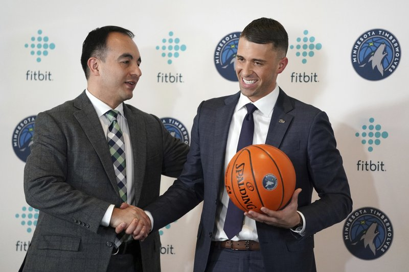 Minnesota Timberwolves President of Basketball Operations Gersson Rosas, left, shakes hands  with the teams new head coach, Ryan Saunders, after a press conference in Minneapolis, Tuesday, May 21, 2019. (Anthony Souffle/Star Tribune via AP)