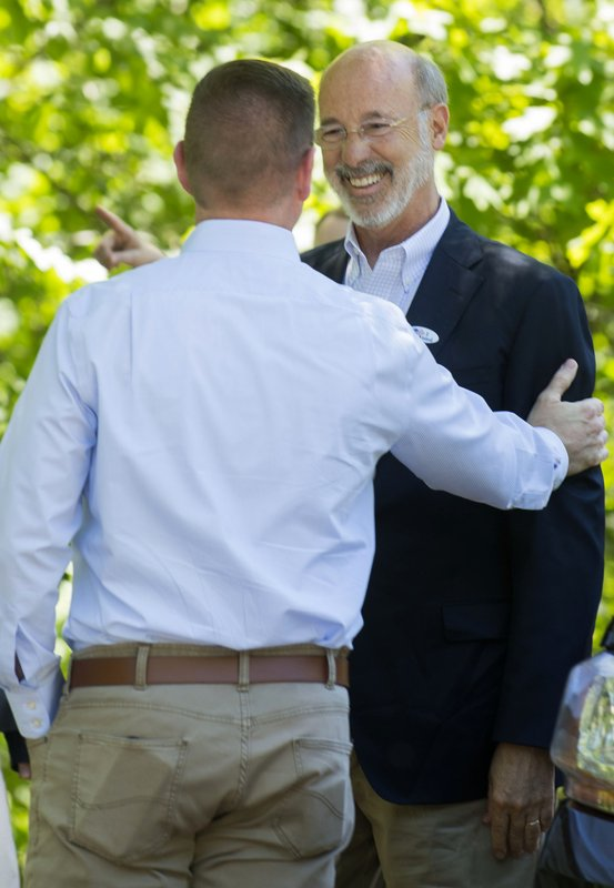 Pennsylvania Sen. John T. Yudichak, left, welcomes Governor Tom Wolf to Glen Onoko Falls in Jim Thorpe, Pa., Tuesday afternoon.State officials say the hiking trail will remain closed to the public unless lawmakers pass Gov. Tom Wolf's $4.5 billion infrastructure plan.   (Bob Ford/Erie Times-News via AP)