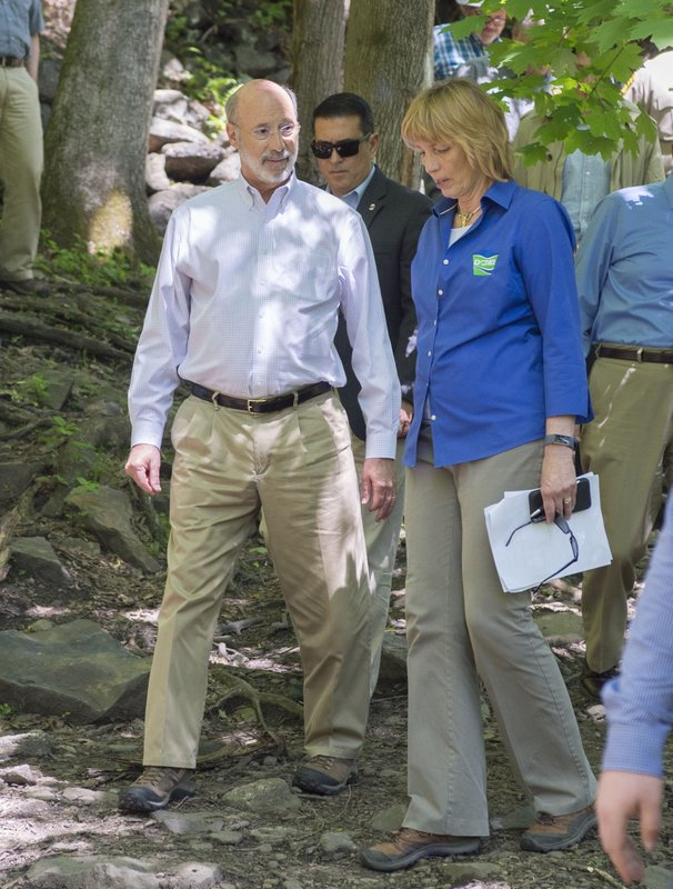Governor Tom Wolf talks with DCNR Secretary Cindy Adams Dunn as they walk down the Falls Trail at Glen Onoko Falls in Jim Thorpe, Pennsylvania Tuesday, May 21, 2019. State officials say the hiking trail will remain closed to the public unless lawmakers pass Gov. Tom Wolf's $4.5 billion infrastructure plan.   (Bob Ford/Erie Times-News via AP)