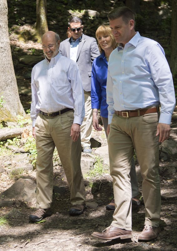 Governor Tom Wolf, DCNR Secretary Cindy Adams Dunn and Pennsylvania Senator John T. Yudichak walk down the Falls Trail at Glen Onoko Falls in Jim Thorpe, Pa. Tuesday, May21, 2019. State officials say the hiking trail will remain closed to the public unless lawmakers pass Gov. Tom Wolf's $4.5 billion infrastructure plan.   (Bob Ford/Erie Times-News via AP)