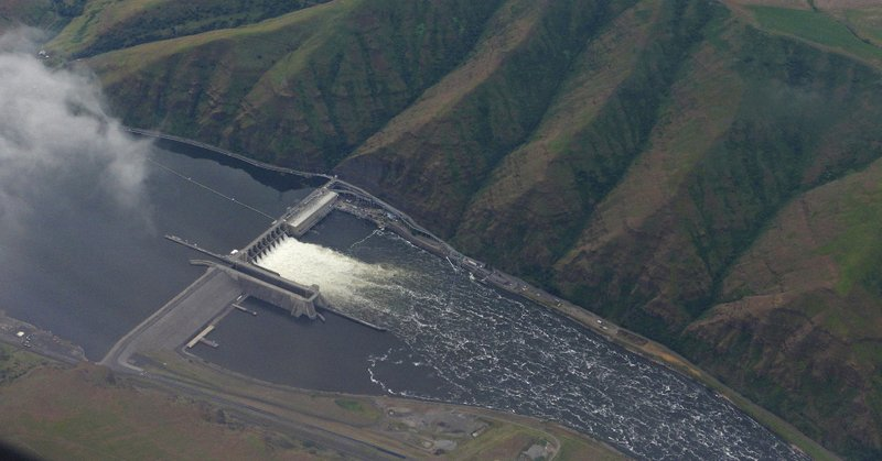 In this May 15, 2019 photo, the Lower Granite Dam on the Snake River is seen from the air near Colfax, Washington Gov. Jay Inslee signed the state's operating budget Tuesday, May 21, 2019 that provides $750,000 to study how to best help impacted communities if the Lower Granite and three other federal dams on the Snake River are breached. The dams are blamed for reducing salmon numbers on the Snake and Columbia river systems. (AP Photo/Ted S. Warren)
