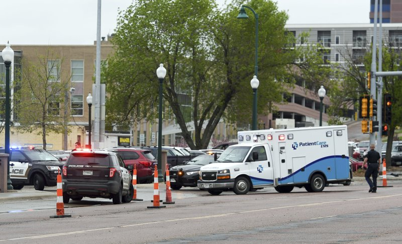 An ambulance arrives on scene after a man was shot by law enforcement outside the Minnehaha County Jail in Sioux Falls, S.D., Tuesday, May 21, 2019. Authorities say a man was shot outside of a South Dakota jail after he charged at an officer with a knife. (Erin Bormett/The Argus Leader via AP)