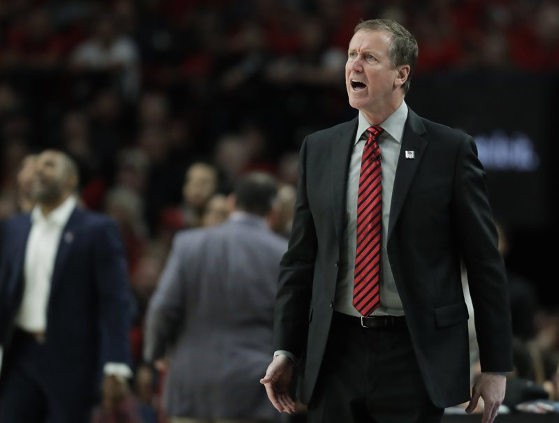 Portland Trail Blazers head coach Terry Stotts calls to his team during the first half of Game 4 of the NBA basketball playoffs Western Conference finals against the Golden State Warriors, Monday, May 20, 2019, in Portland, Ore. (AP Photo/Ted S. Warren)