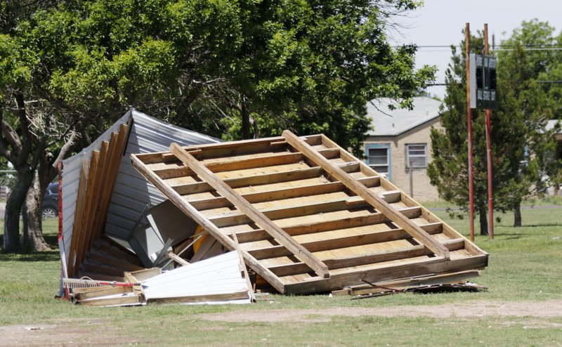 A baseball equipment storage shed lays in a heap next to the baseball fields at Floyd Gwin Park, Tuesday, May 21, 2019, in Odessa, Texas, the day after a severe storm passed through. (Mark Rogers/Odessa American via AP)