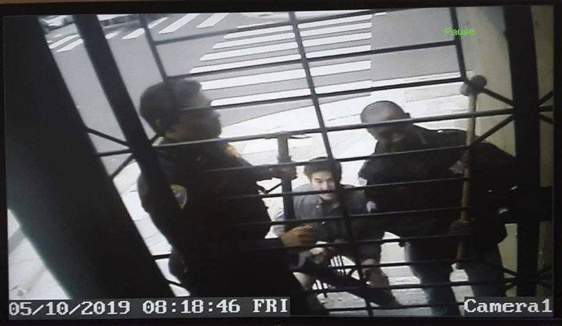 In this May 10, 2019, image from video provided by Bryan Carmody San Francisco police armed with sledgehammers execute a search warrant at journalist Bryan Carmody's home in San Francisco. The San Francisco reporter is seeking the return of property after police raided his home, as officials sought to determine the source of a leaked police report into the death of the city's public defender. An attorney for Carmody will make the request Tuesday, May 21 in San Francisco County Superior Court. (Bryan Carmody/@bryanccarmody via AP)