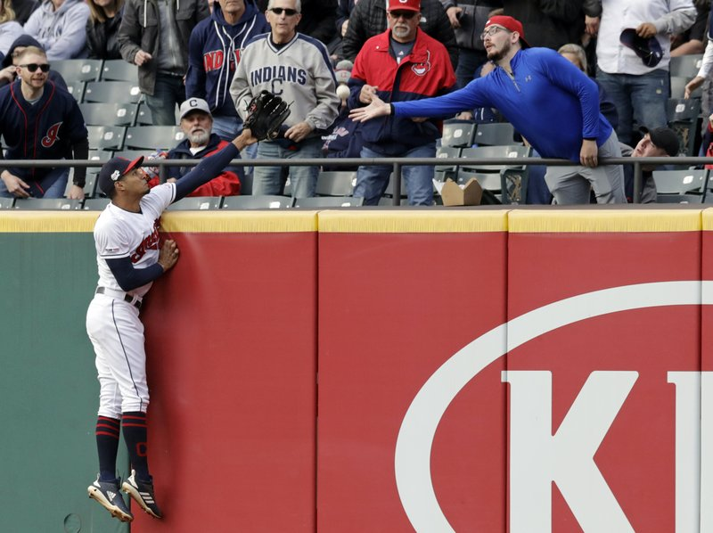 Cleveland Indians' Oscar Mercado reaches but can't catch a two-run home run ball hit by Oakland Athletics' Mark Canha in the third inning of a baseball game, Tuesday, May 21, 2019, in Cleveland. Matt Olson scored on the play. (AP Photo/Tony Dejak)