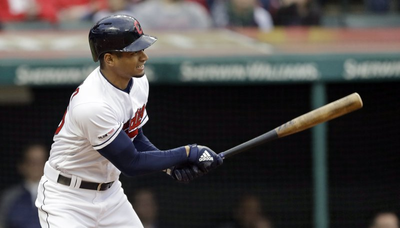 Cleveland Indians' Oscar Mercado watches his ball after hitting a one-run double in the fourth inning of a baseball game against the Oakland Athletics, Tuesday, May 21, 2019, in Cleveland. Leonys Martin scored on the play. (AP Photo/Tony Dejak)