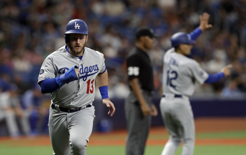 Los Angeles Dodgers' Max Muncy (13) scores on a single by Justin Turner and an error by Tampa Bay Rays right fielder Avisail Garcia during the first inning of a baseball game Tuesday, May 21, 2019, in St. Petersburg, Fla. (AP Photo/Chris O'Meara)