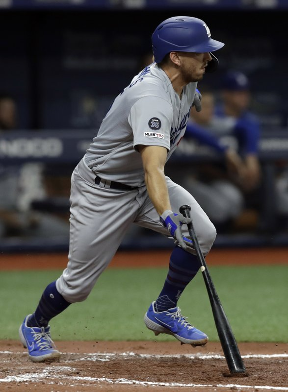 Los Angeles Dodgers' Austin Barnes watches his RBI single off Tampa Bay Rays relief pitcher Jalen Beeks during the fourth inning of a baseball game Tuesday, May 21, 2019, in St. Petersburg, Fla. (AP Photo/Chris O'Meara)