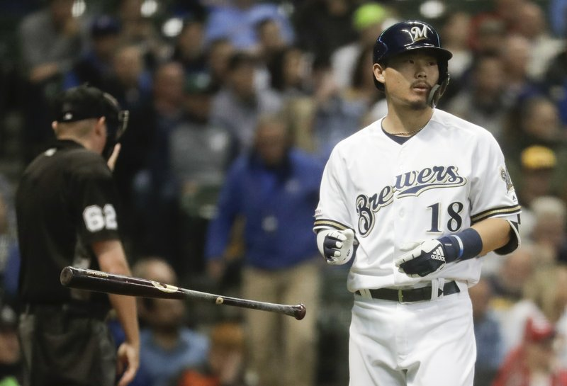 Milwaukee Brewers' Keston Hiura reacts after striking out during the fourth inning of a baseball game against the Cincinnati Reds Tuesday, May 21, 2019, in Milwaukee. (AP Photo/Morry Gash)