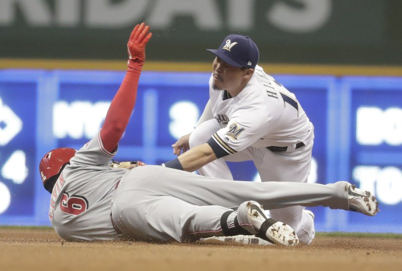 Cincinnati Reds' Phillip Ervin slides safely into second for a double under the tag of Milwaukee Brewers' Keston Hiura during the first inning of a baseball game Tuesday, May 21, 2019, in Milwaukee. (AP Photo/Morry Gash)