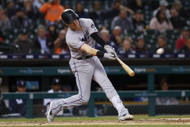 Miami Marlins' Brian Anderson hits a solo home run during the seventh inning of the team's baseball game against the Detroit Tigers in Detroit, Tuesday, May 21, 2019. (AP Photo/Paul Sancya)