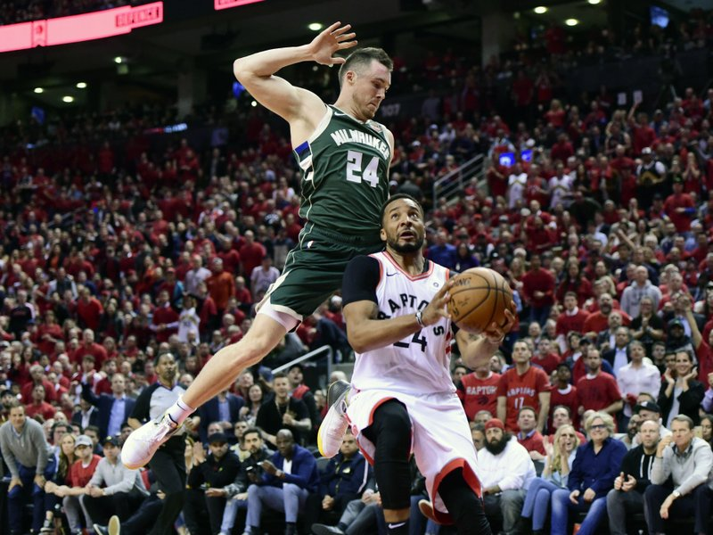Toronto Raptors forward Norman Powell (24) heads for the baskets as Milwaukee Bucks guard Pat Connaughton (24) defends during the second half of Game 4 of the NBA basketball playoffs Eastern Conference finals, Tuesday, May 21, 2019 in Toronto. (Frank Gunn/The Canadian Press via AP)