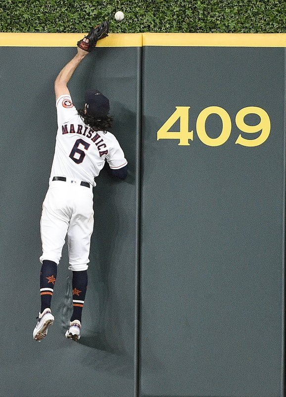 Houston Astros center fielder Jake Marisnick misses the solo home run ball of Chicago White Sox's Jose Abreu during the seventh inning of a baseball game, Tuesday, May 21, 2019, in Houston. (AP Photo/Eric Christian Smith)