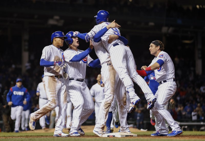Chicago Cubs' Javier Baez (9) celebrates with teammates after hitting a game winning RBI-single against the Philadelphia Phillies during the ninth inning of a baseball game, Tuesday, May 21, 2019, in Chicago. (AP Photo/Kamil Krzaczynski)