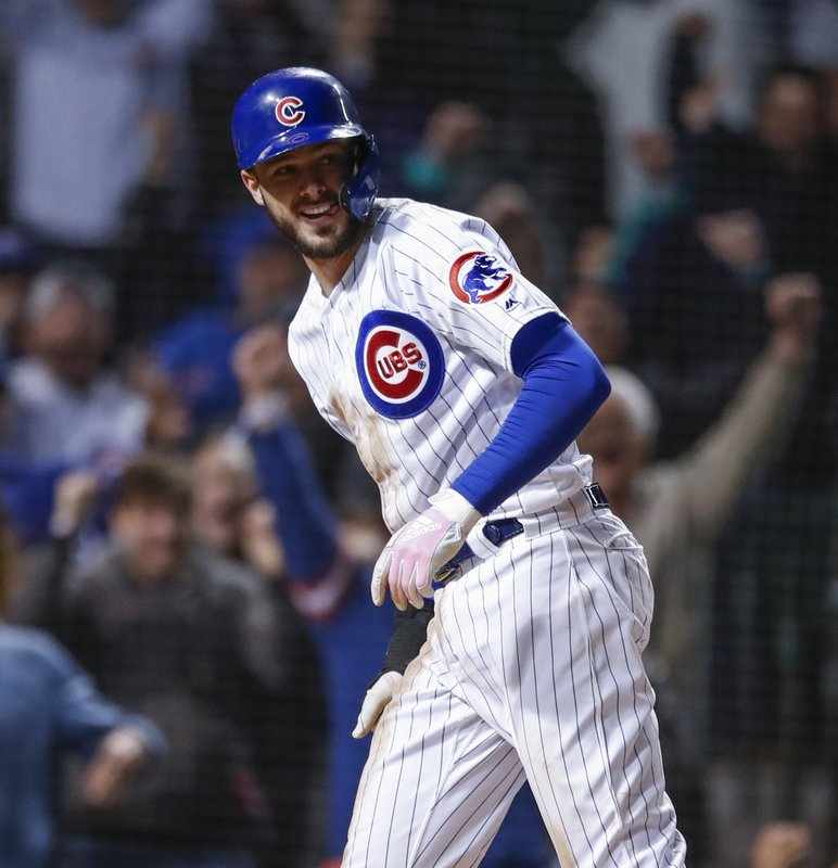 Chicago Cubs' Kris Bryant smiles after scoring against the Philadelphia Phillies during the ninth inning of a baseball game, Tuesday, May 21, 2019, in Chicago. (AP Photo/Kamil Krzaczynski)