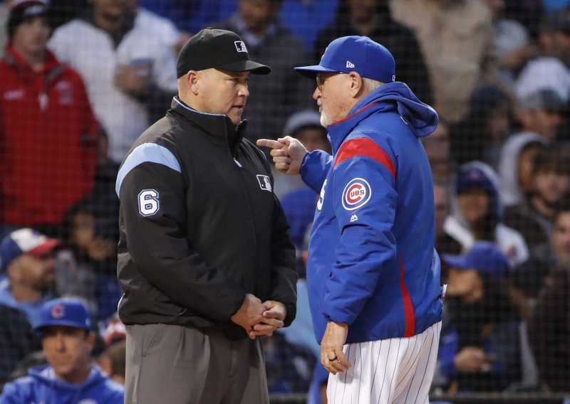 Chicago Cubs manager Joe Maddon, right, argues a call against his team with umpire Mark Carlson, left, during the fourth inning of a baseball game, Tuesday, May 21, 2019, in Chicago. (AP Photo/Kamil Krzaczynski)