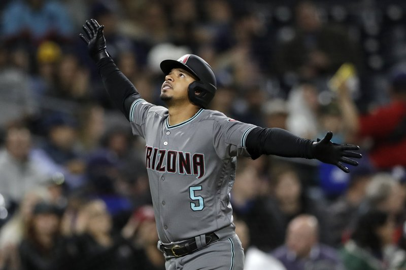 Arizona Diamondbacks' Eduardo Escobar looks up after hitting a home run during the fourth inning of a baseball game against the San Diego Padres, Tuesday, May 21, 2019, in San Diego. (AP Photo/Gregory Bull)